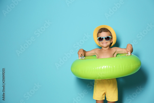 obraz PCV Cute little boy with inflatable ring on color background