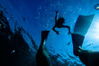 Silhouettes of diving people