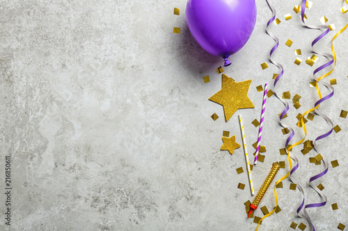 Flat lay composition with party decor and air balloon on grunge background