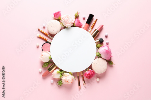 Obraz Flat lay composition with card and products for decorative makeup on pastel pink background - fototapety do salonu