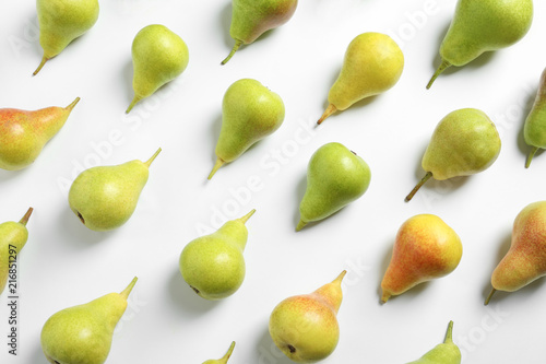 Ripe juicy pears on white background, top view
