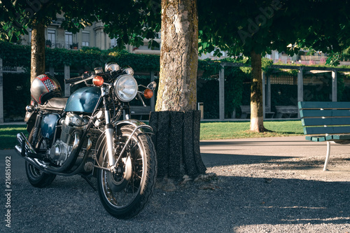 Canvas two classic style cafe racer motorcycle at sunset time