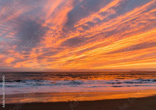 Fotobehang Diepbruine Pacific Ocean Sunset