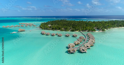 Foto auf Leinwand Reef grun Water bungalows resort at islands, french polynesia in aerial view