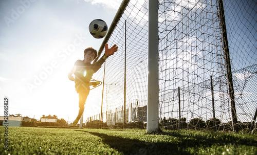 Goalkeeper jumping at stadium over sunsetlight Canvas Print
