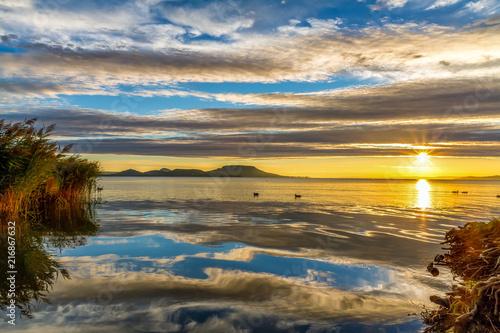 Valokuva  Beautiful colorful sunrise, lake Balaton in Hungary