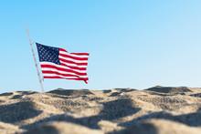 American Flag In The Sand Agai...