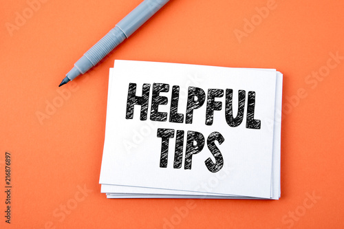 Fotografía  Helpful Tips, Business Concept. Paper note with text