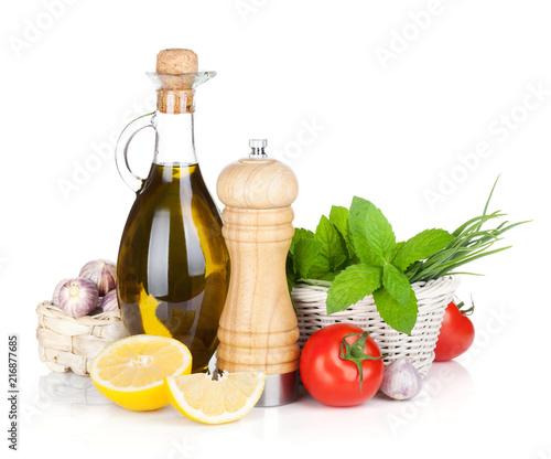 Fotobehang Aromatische Fresh herbs, tomato, olive oil and pepper shaker