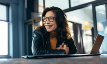 Smiling Asian Businesswoman At Office