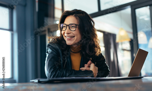 Smiling asian businesswoman at office Wallpaper Mural