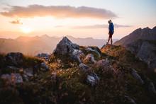 Hiker Girl Enjoying A Sunset On Top Of A Peak
