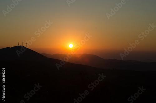 Staande foto Zwart Wind turbine sunset hdr photo ecology