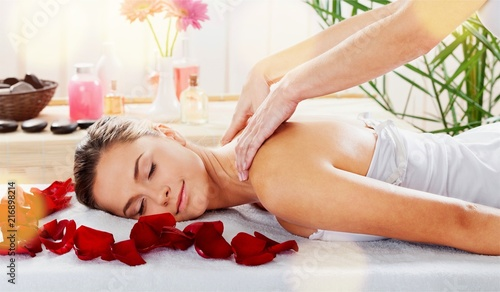 Beautiful young woman relaxing with massage