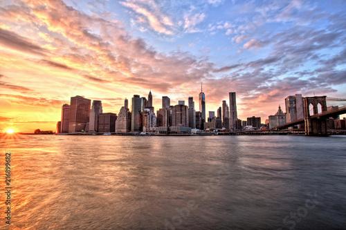 Deurstickers New York City New York City Lower Manhattan with Brooklyn Bridge at Sunset