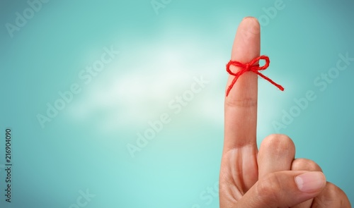 Rope bow on finger pointing Tablou Canvas