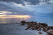 Rain pours from dark clouds over Clam Pass Beach in Naples, Florida
