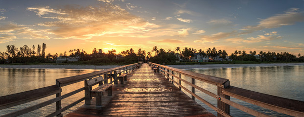 Early sunrise over the Naples Pier on the Gulf Coast of Naples, Florida