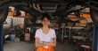 Portrait of a young beautiful car mechanic in a car workshop, in the background of service. car service concept. dolly shot