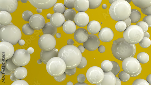 White spheres of random size on yellow background