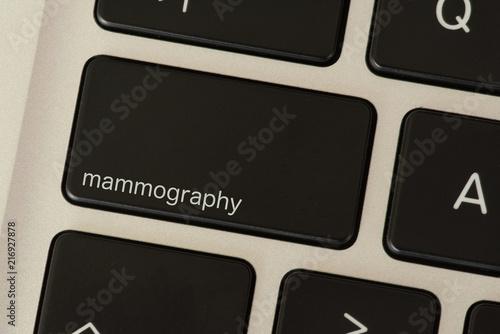 Fototapety, obrazy: Ein Computer und eine Taste für die Mammographie