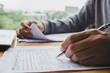 Leinwandbild Motiv Closeup of man hand filling income tax forms