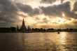Wat Arun Temple Beside Chao Phraya River with Beautiful Sunshine Through the Cloud, Bangkok, Thailand. One of the Most Famous Place of Thailand's Landmarks.
