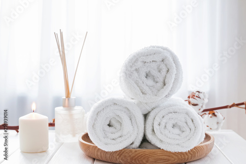 Foto op Canvas Spa White towels on the wooden tray, candle and aroma diffuser.