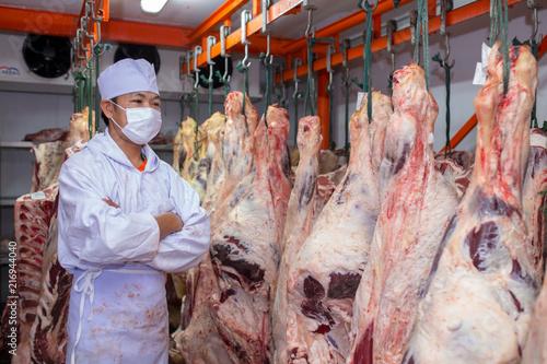 Butcher standing beef in meat curing plants Wallpaper Mural