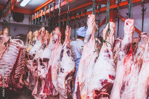 Staande foto Vlees Butchers work in meat curing.