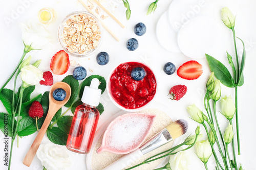 Photo  Different bright set skin care beauty products above on white table, ingredients prepared for making cosmetics