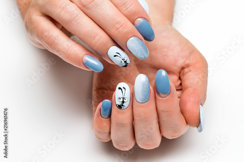 Aluminium Prints Manicure festive blue manicure with sequins on long oval nails with painted ant