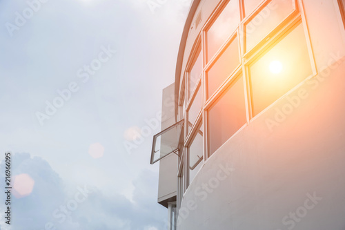Fototapeta  Hot weather high sunny day office windows UV protection exterior outdoor