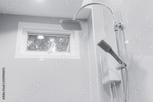 clean new the bathroom shower head with awning windows for air ventilation