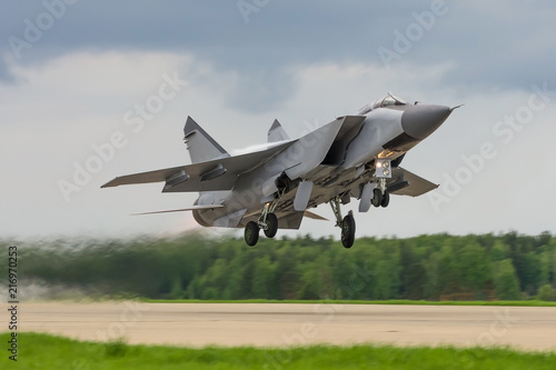 Air military bomber perfoming take off from the airbase runway in Russia Wallpaper Mural