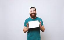 Cheerful Bearded Man Showing B...