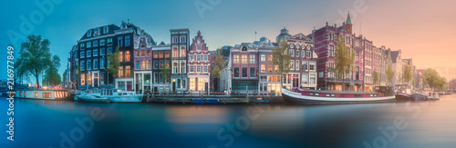 Foto op Canvas Amsterdam River, canals and traditional old houses Amsterdam