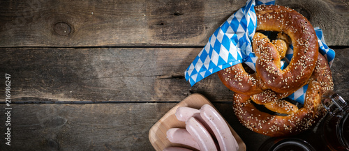 Fényképezés Oktoberfest concept - traditional food and beer on rustic background