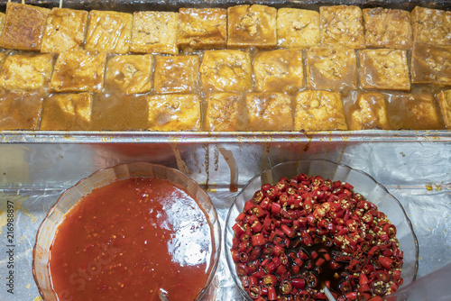 Fotografie, Obraz  Popular stinky tofu with spicy sauce selling in the Jiufen , old street food mar