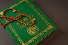 Prayer Beads Kept On Holy Quran