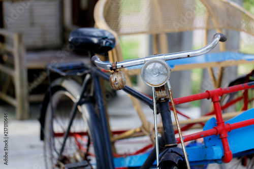 Spoed Foto op Canvas Fiets Three wheeled passenger seat in the ancient