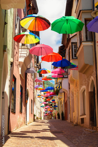 Valokuvatapetti Colored umbrellas decorates alley in old town in Chiusa Italy