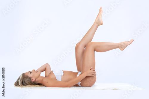 Foto op Canvas Gymnastiek woman for beauty center on the studio