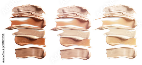 Foto Makeup product smears on white background