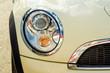 Car head light white beige in the street