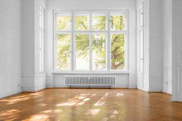 window in empty room, old apartment building with parquet floor