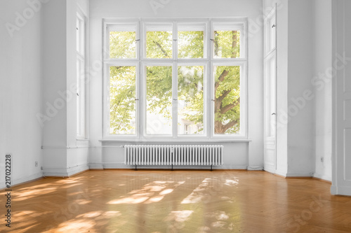 window in empty room, old apartment building with parquet floor