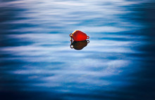 Red Buoy On The Water.