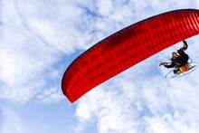Motor Paraglider Flying In Blu...