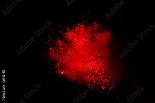 Obraz na plátne Abstract of red powder explosion on black background